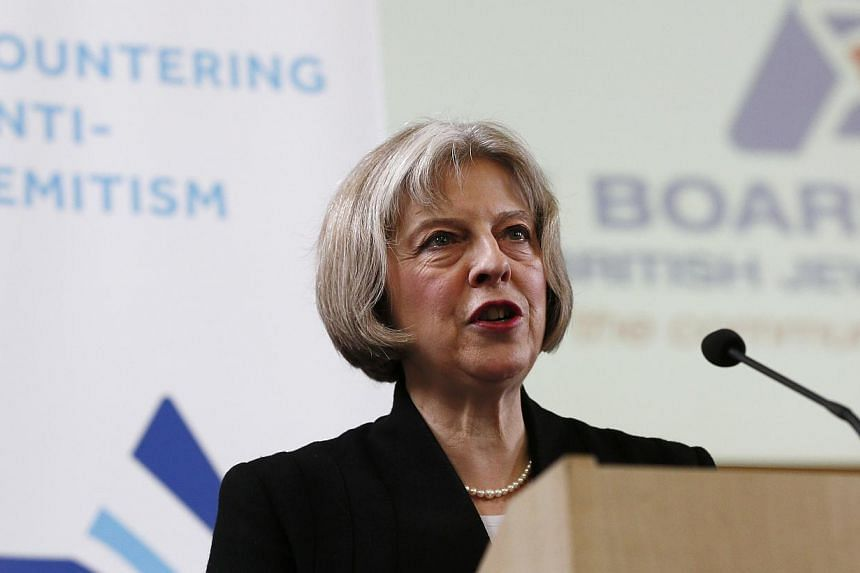 """Britain's Home Secretary Theresa May speaks during a Board of Deputies of British Jews event in London on Jan 18, 2015.Britain needs to address an """"appalling"""" spike in anti-Semitism, Ms May said on Sunday in a speech to the Jewish community des"""