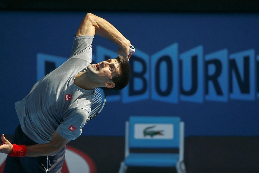 Serbia's Novak Djokovic serves during a practice session on Rod Laver Arena at Melbourne Park on Jan 18, 2015.The world No. 1 seed said on Sunday he has shrugged off a stomach bug and has a good chance to win the Australian Open on the 10th ann