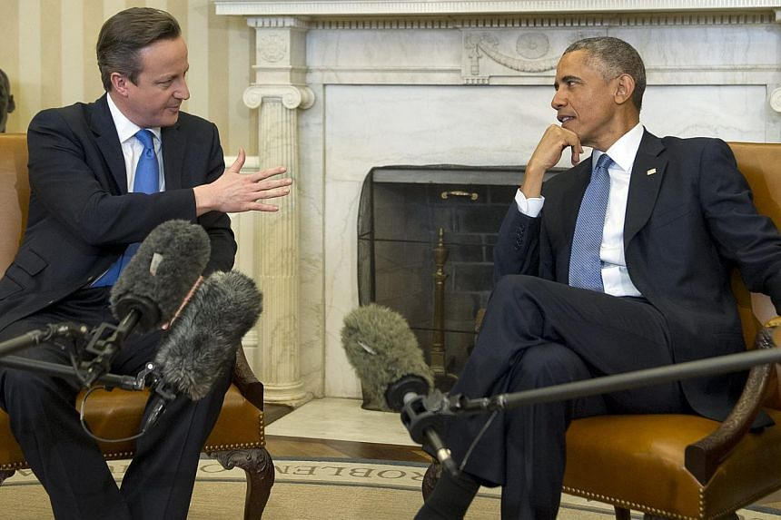 United States President Barack Obama (right) meets Prime Minister David Cameron (left) of the United Kingdom in the Oval Office of the White House in Washington, DC, USA on 16 Jan 2015. British Foreign Secretary Philip Hammond and United States Secre