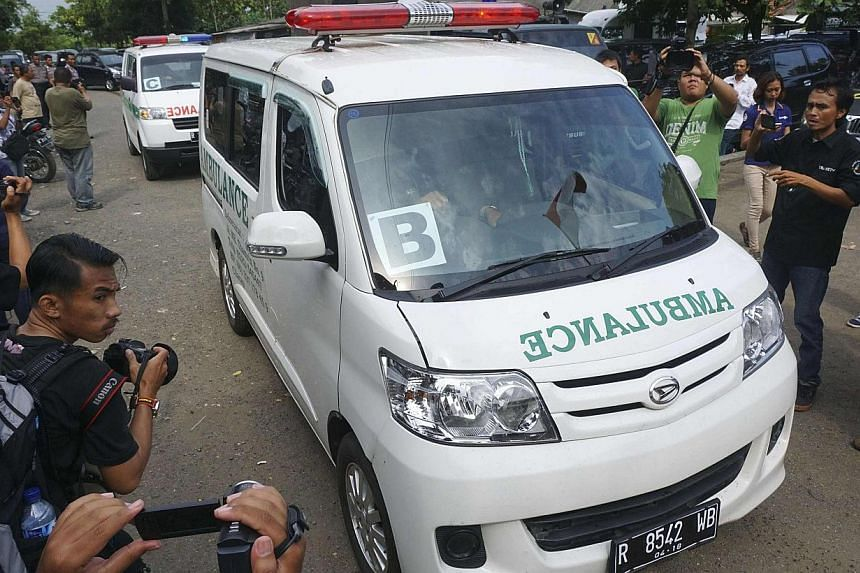A convoy of ambulances carrying coffins make their way to Nusa Kambangan prison at Wijayapura quay, Cilacap, Central Java, on Jan 17, 2015. Indonesia on Sunday put to death six people convicted of drugs offences, including five foreigners, in the fir