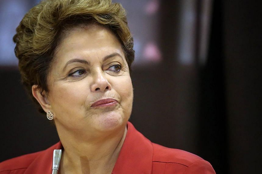 """Brazilian President Dilma Rousseff(above) was """"distressed and outraged"""" after Indonesia defied her repeated pleas and executed one of her countrymen convicted of drug trafficking, a spokesman said Saturday. -- PHOTO: AFP"""