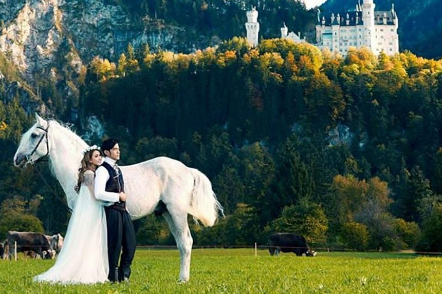 A fairy-tale romance is captured in this photo where Jay Chou and Hannah Quinlivan are dressed like a prince and a princess with a white stallion, in front ofNeuschwanstein Castle in Germany.-- PHOTO: FACEBOOK / JAY CHOU