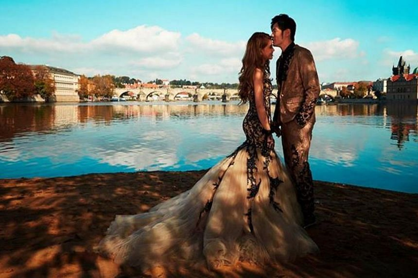 Hannah Quinlivan dons a frothy gown in this shot where the couple is pictured against a spectacular backdrop of Charles Bridge in Prague.-- PHOTO: FACEBOOK / JAY CHOU