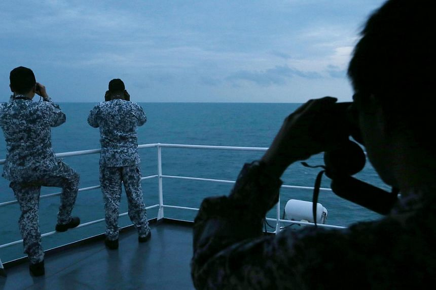 Sailors on board MV Swift Rescue during the search for QZ8501 on Jan 7, 2015. -- ST PHOTO: SEAH KWANG PENG