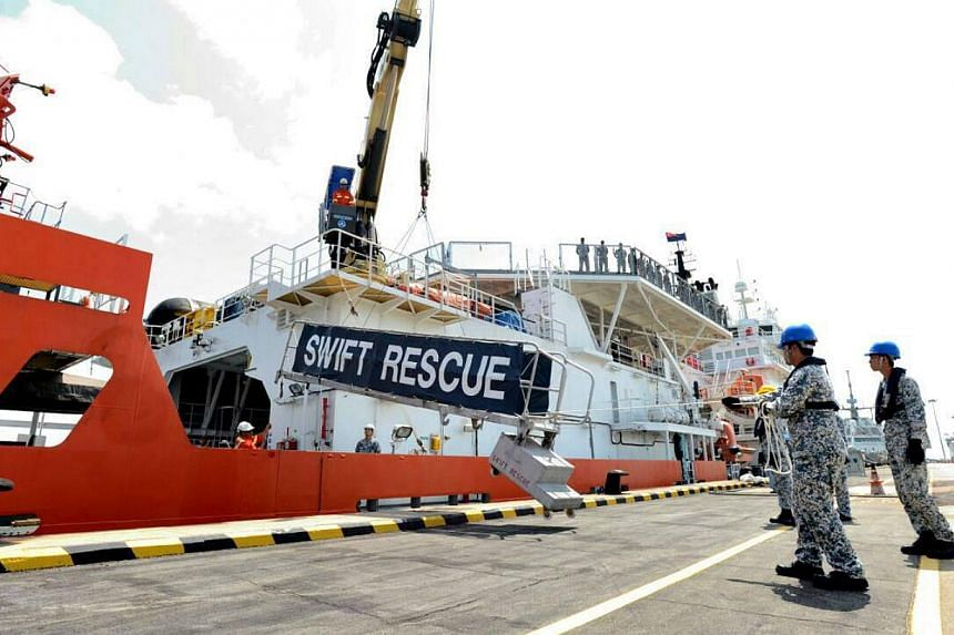 Lowering the gangway after the MV Swift Rescue returned to Changi Naval Base after 20 days at sea.-- PHOTO: NG ENG HEN/FACEBOOK
