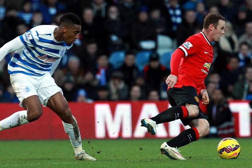 QPR's Leroy Fer and Wayne Rooney of Manchester United during their teams' Premier League game on Jan 17, 2015. Marouane Fellaini and James Wilson came off the substitutes' bench to earn Manchester United a 2-0 victory at struggling Queens Park Ranger