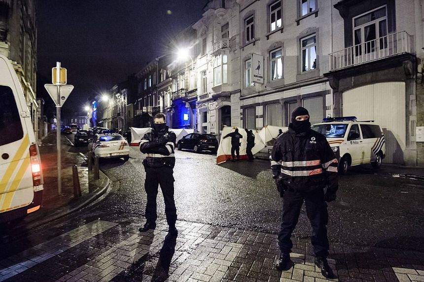 Belgian police block a street in central Verviers in the east of Belgium on Jan 15, 2015.At least four people were arrested in Athens on Saturday as part of a probe into an Islamic militant cell that was dismantled in Belgium this week before i
