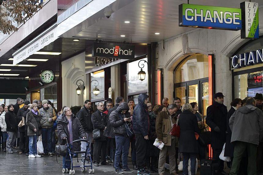 A day after the Swiss National Bank abandoned the Swiss franc's peg to the euro last Thursday, sending the franc soaring, queues like this formed at currency exchange offices in Geneva.