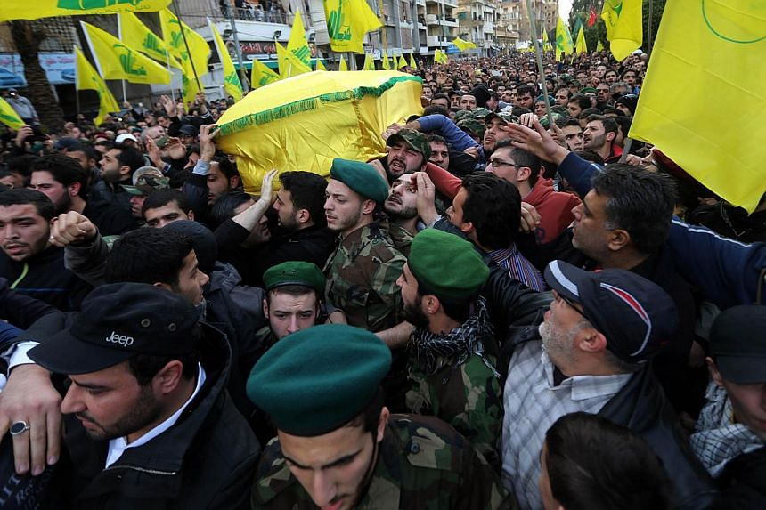 Lebanese Hezbollah supporters carry the coffin of militant Jihad Mughniyeh during his funeral in a southern Beirut suburb on Jan 19, 2015. The fundamental origins of Islamist extremism and militancy lie in the failure of Muslim states, and other stat
