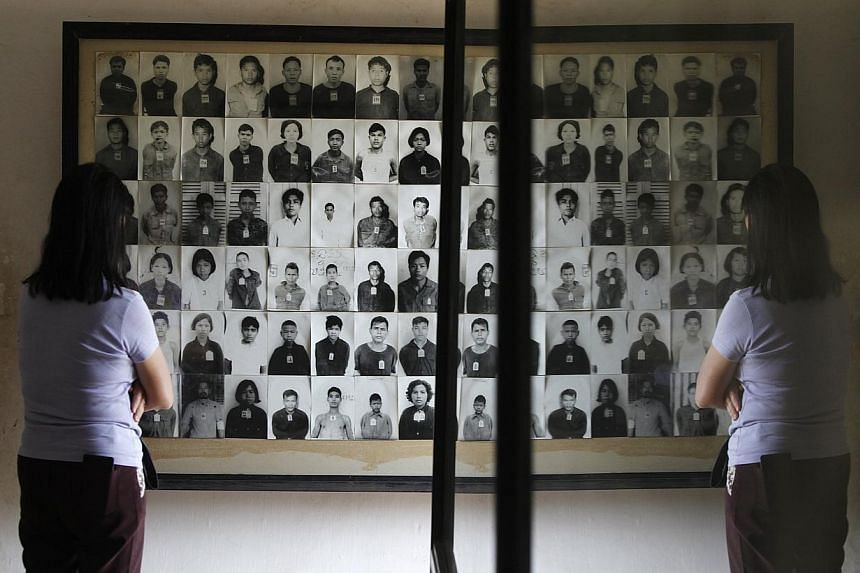A tourist looks at photographs of Khmer Rouge victims at the Tuol Sleng Genocide Museum, also known as the notorious security prison S-21, in Phnom Penh on Jan 21, 2015.A witness told Cambodia's UN-backed court Wednesday that Khmer Rouge soldie