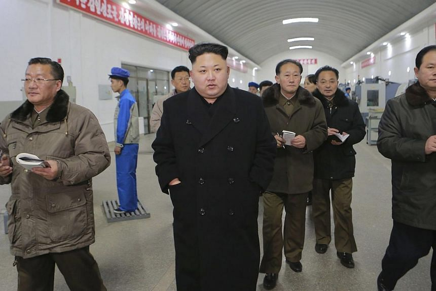 North Korean leader Kim Jong Un (centre) visits the Kangdong Precision Machine Plant in this undated photo released by North Korea's Korean Central News Agency (KCNA) in Pyongyang on Jan16, 2015. North Korea threatened to reconsider proposals for dia