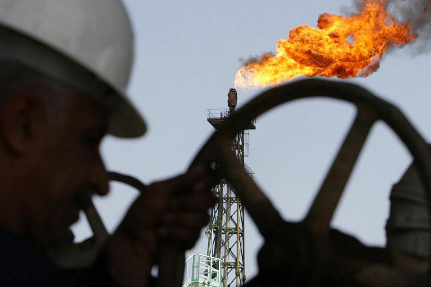 An Iraqi worker opens a pipe at Sheaiba oil refinery in Basra in this Mar 29, 2007.Oil prices are unlikely to fall further after a plunge of nearly 60 per cent since June, Iraqi Oil Minister Adel Abdul Mahdi said on Wednesday. -- PHOTO: REUTERS