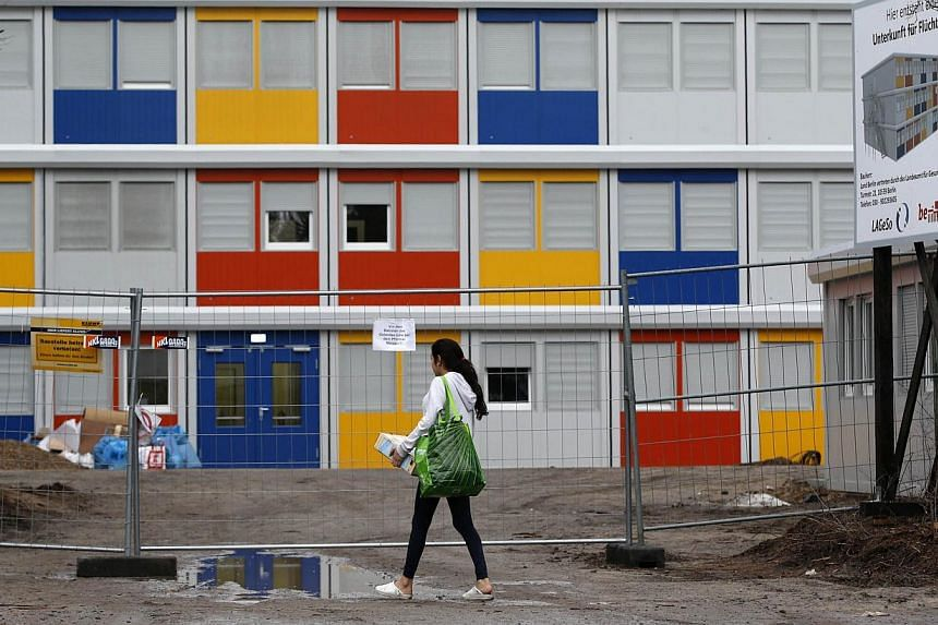 A resident enters a new refugee centre for housing asylum seekers in the Koepenick district of Berlin on Jan 2, 2015.Germany's population rose to 81.1 million people in 2014, the fourth annual increase in a row, boosted by the highest level of