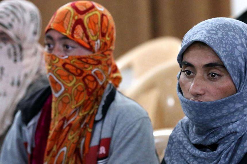 Yazidi women at Al-Tun Kopri health centre, located halfway between the northern Iraqi city of Kirkuk and Arbil, after they were released on Jan 17, 2015 after being held by ISIS militants for more than five months. The terrorist group is now said to