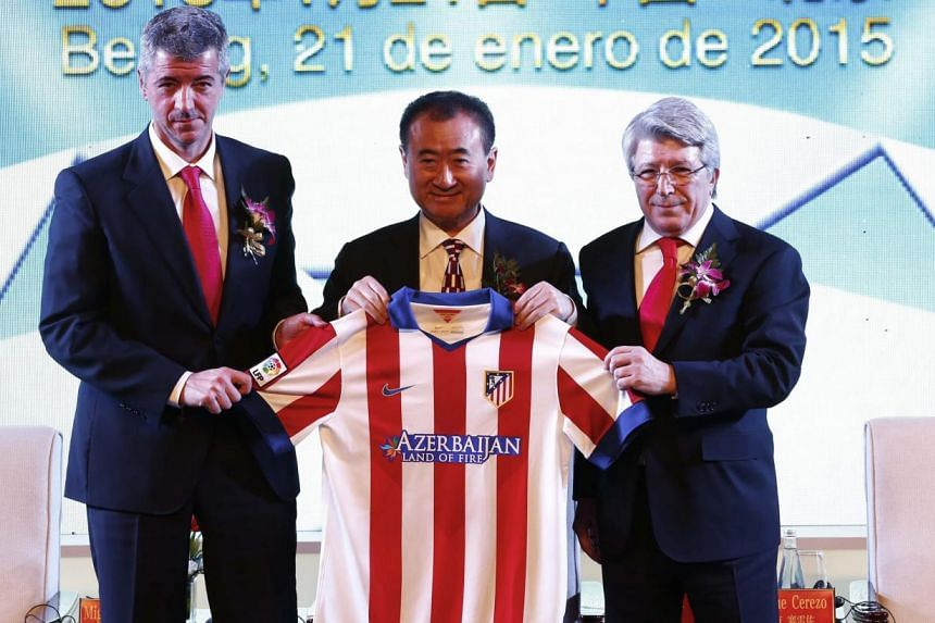 (From left) Atletico Madrid CEO Miguel Angel Gil, Wanda Group chairman Wang Jianlin and Atletico Madrid president Enrique Cerezo during an agreement ceremony in Beijing, China on Jan 21, 2015. -- PHOTO: EPA