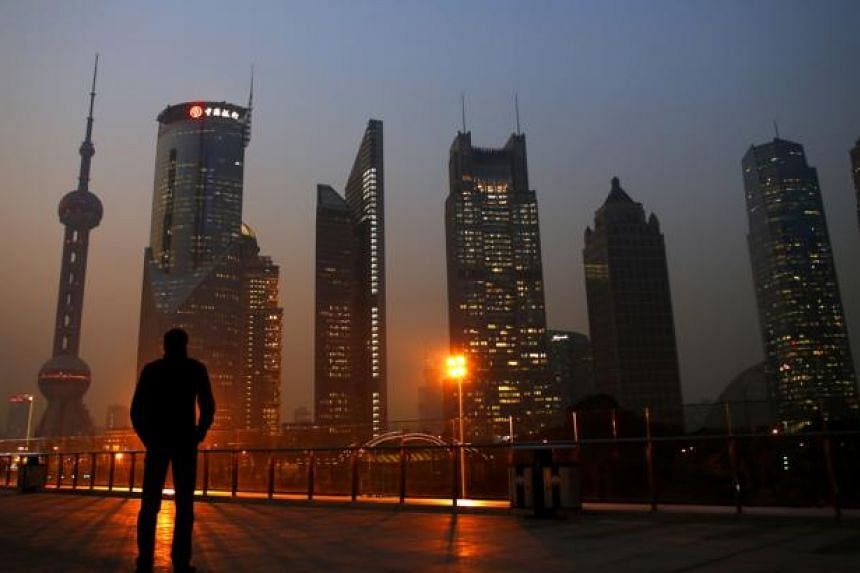 China shares soared on Wednesday, Jan 21, 2015, with the Shanghai Composite Index producing its biggest one-day percentage gain in more than five years as investor confidence continued to recover after Monday's plunge.-- PHOTO: REUTERS