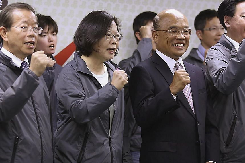 Taiwan's main opposition Democratic Progressive Party (DPP) Chairperson Tsai Ing-wen (second left) and party officials celebrate winning the local elections in Taipei on Nov 29, 2014. The DPP on Wednesday, Jan 21, 2015, said relations with China