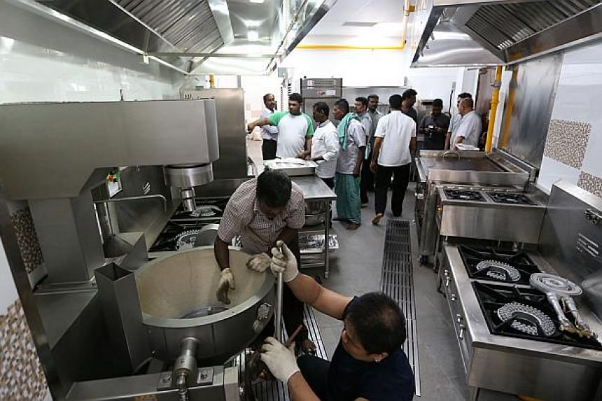 The Sri Senpaga Vinayagar temple's new kitchen is equipped with a 150-litre machine for curries, an automated vegetable cutter, automated rice washer and combi-oven steamer which can produce 250 pieces of idli (steamed cakes) in 10 minutes. -- ST PHO
