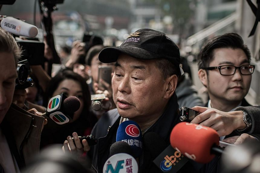 Media tycoon Jimmy Lai after walking out of the Wanchai police station in Hong Kong on Jan 21, 2015. -- PHOTO: AFP