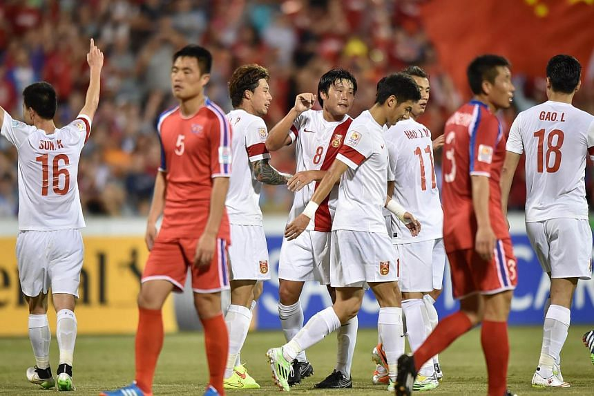 China (in white) celebrate scoring their second goal against North Korea during their Group B football match of the AFC Asian Cup in Canberra on Jan 18, 2015. North Korea have withdrawn from a friendly tournament in Thailand next month because of int
