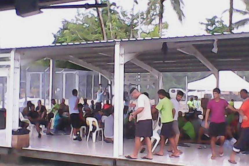 Asylum seekers are pictured in this handout photo provided by the refugee action coalition, taken inside the Manus Island detention centre in Papua New Guinea on Jan 13, 2015. A protest by hundreds of asylum seekers at the Australian detention centre