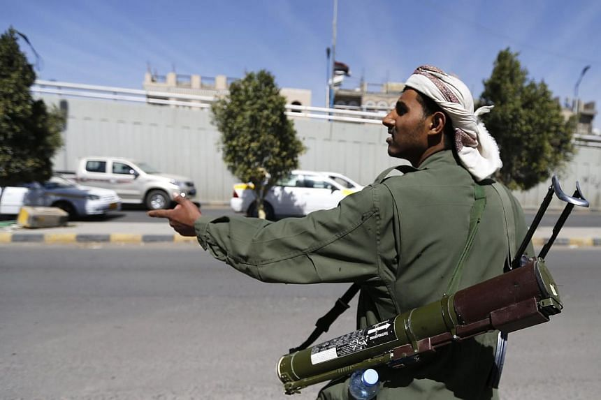 A Houthi fighter mans a checkpoint on a road leading to the Presidential Palace in Sanaa, Yemen, on Jan 20, 2015.Authorities in Yemen's second city Aden shut its international airport on Wednesday, Jan 21, in protest against attacks by Shi'ite