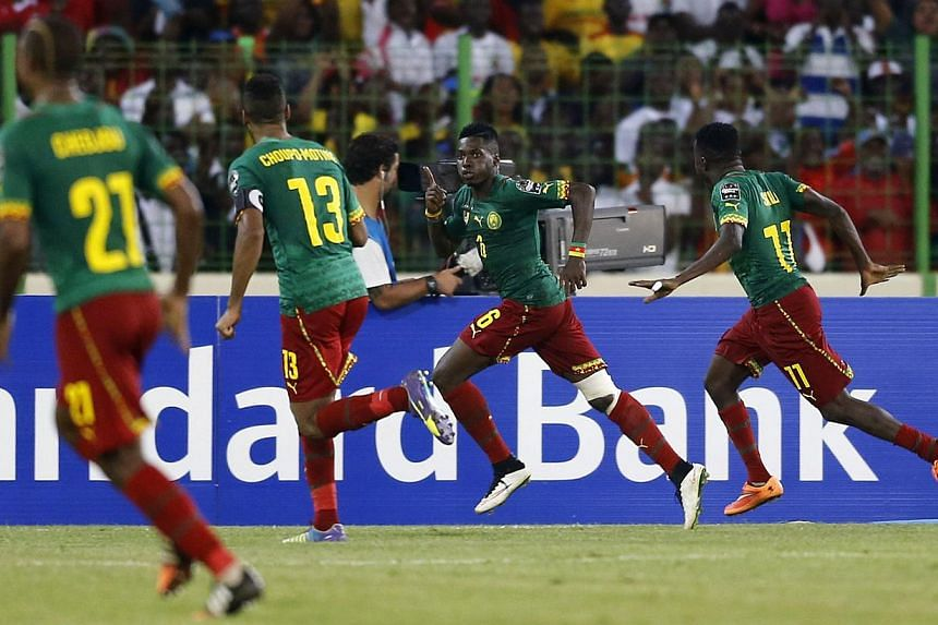 Cameroon's Ambroise Oyongo (second from right) celebrating his goal against Mali during their 2015 African Cup of Nations Group D football match in Malabo on Jan 20, 2015. -- PHOTO: REUTERS