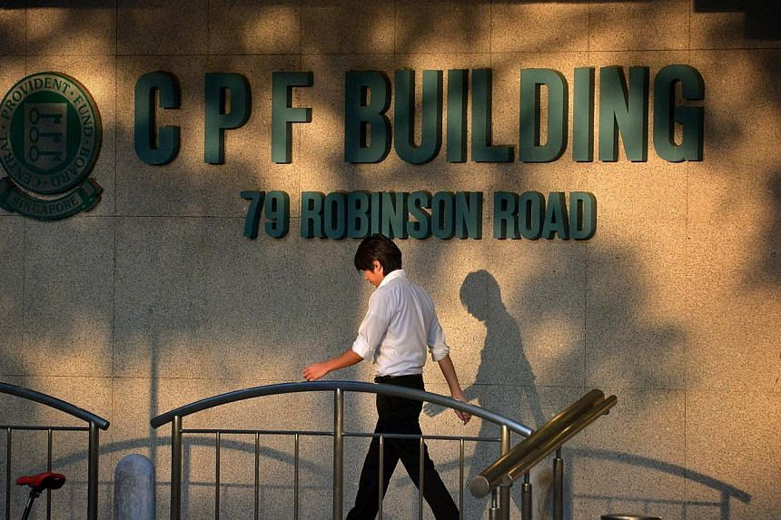 People walking past the CPF Building logo at the foot of the building along Robinson Road. The National Trades Union Congress (NTUC) has called for an improvement to the Central Provident Fund (CPF) system to better meet the retirement needs of worke