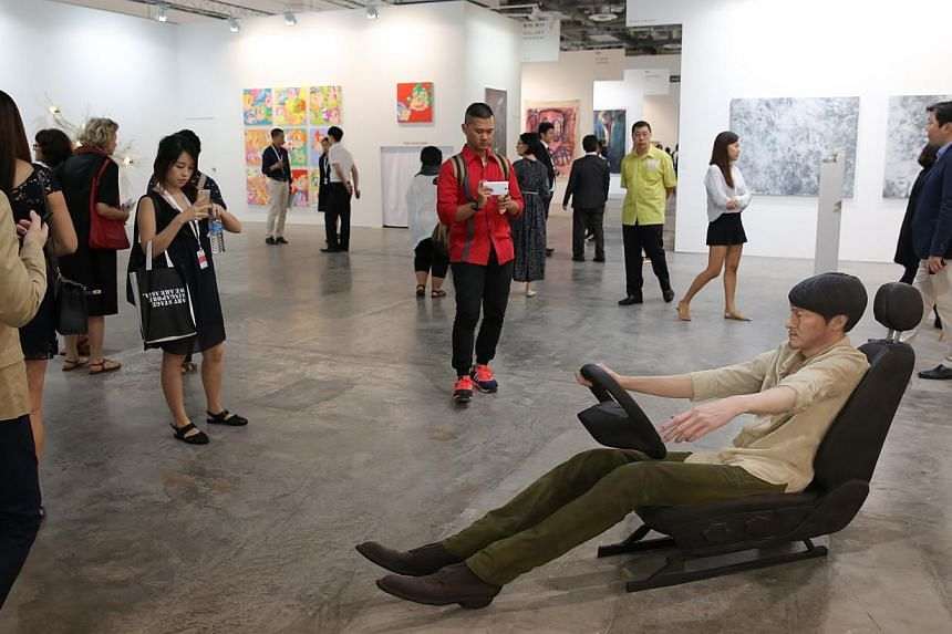 Visitors looking at the are pieces at the the fifth edition of Art Stage Singapore, during a private viewing at the Marina Bay Sands Expo and Convention Centre on Jan 21, 2015.-- ST PHOTO:ONG WEE JIN