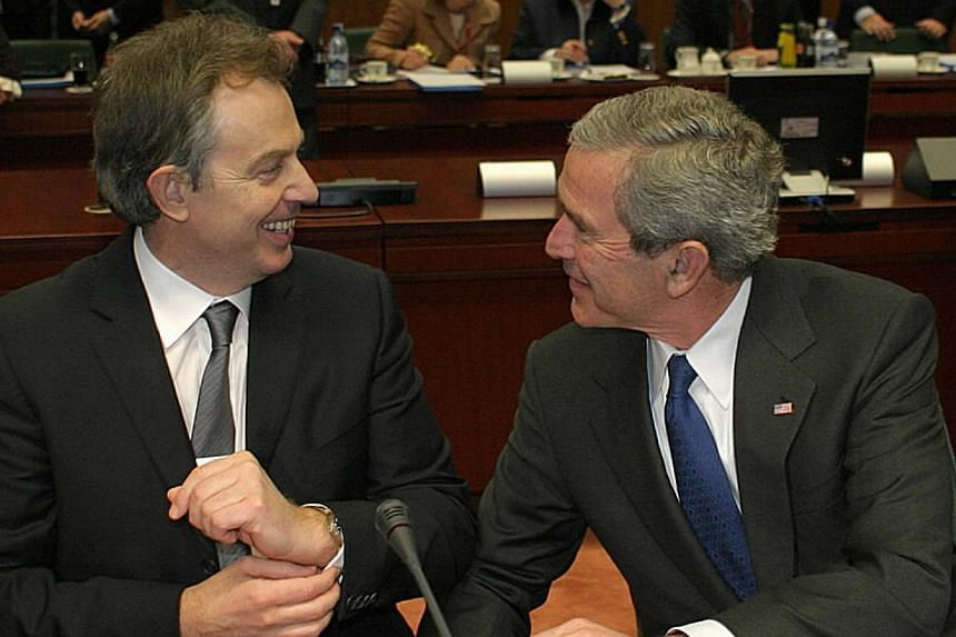 Former US leader George W. Bush with former British PM Tony Blair during the EU-US Leaders' Meeting in Brussels in 2005. Publication has been slowed by disagreement over the release of communications between former British prime minister Tony Blair a