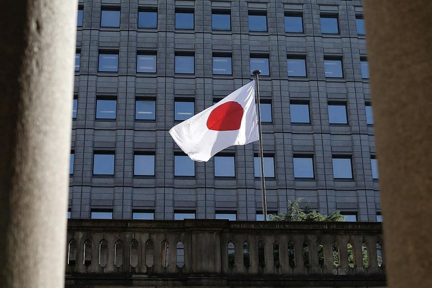 The Bank of Japan has decided to maintain its pledge to increase base money, or cash and deposits at the central bank and extended the deadline of two loan programme. -- PHOTO: REUTERS
