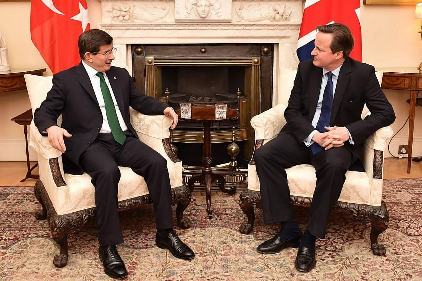 British Prime Minister David Cameron (right) meeting Turkish Prime Minister Ahmet Davutoglu (left) at No. 10, Downing Street, in central London on Jan 20, 2015. -- PHOTO: AFP