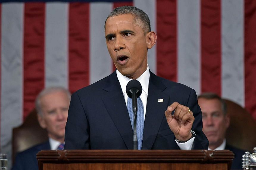 US President Barack Obama delivers the State of The Union address on Jan 20, 2015, at the US Capitol in Washington, DC. Mr Obama on Tuesday called on the US Congress to pass a new authorisation of force against the Islamic State in Iraq and Syria (IS