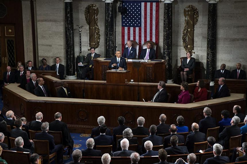 US President Barack Obama delivering the State of The Union address at the US Capitol in Washington, DC on Jan 20, 2015. -- PHOTO: EPA