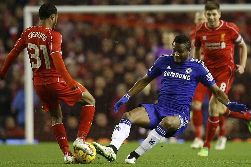 Chelsea's John Obi Mikel challenges Liverpool's Raheem Sterling (left) during their English League Cup semi-final first leg soccer match at Anfield in Liverpool, northern England Jan 20, 2015. -- PHOTO: REUTERS