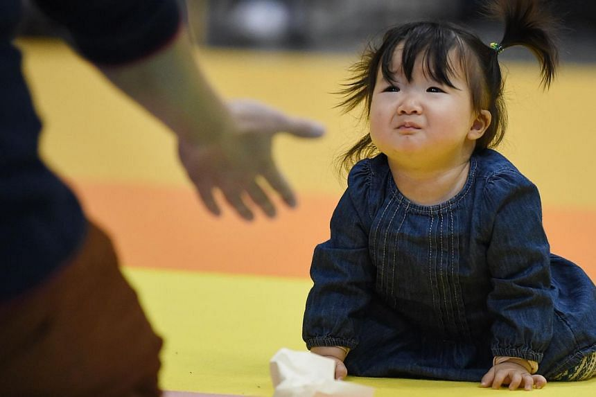 Fertility rates in Japan bottomed out at 1.26 children per woman in 2005, and have been rising since - despite the sharp recession and natural disasters that happened in the meantime. -- PHOTO: AFP