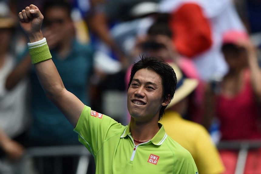 Kei Nishikori of Japan celebrating his victory over Ivan Dodig of Croatia in their men's singles match on day four of the Australian Open in Melbourne on Jan 22, 2015. -- PHOTO: AFP