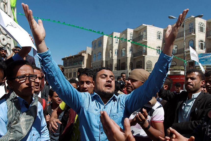 Yemeni protesters shout slogans during a rally against against the control of capital the by Shiite Huthi rebels on Jan 23, 2015 in the capital Sanaa.Yemen drifted deeper into political limbo on Friday after President Abd-Rabbu Mansour Hadi res
