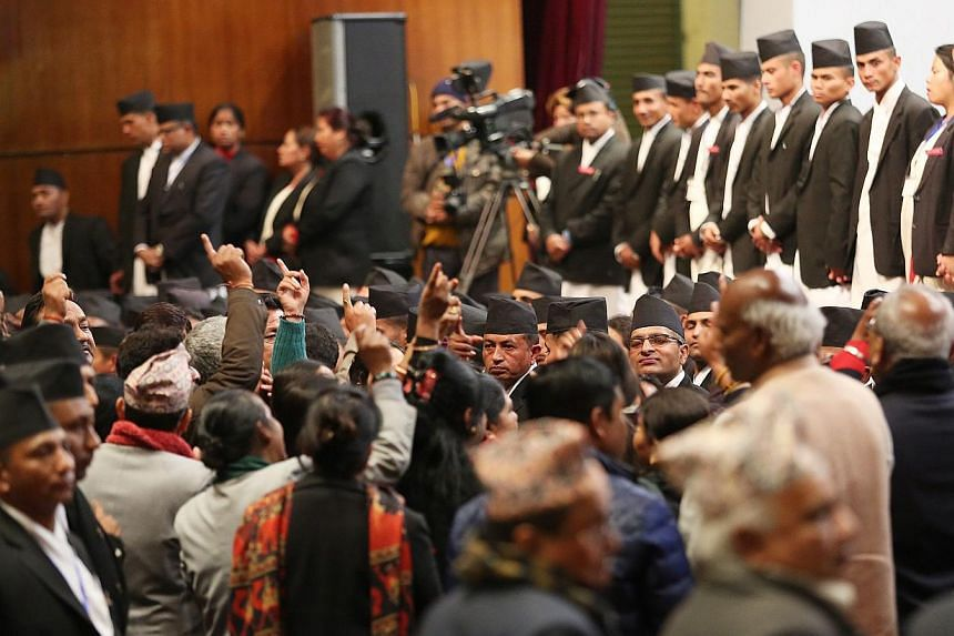 Constitution assembly members shout during the meeting at the parliament on the final day to draft the new constitution in Kathmandu, Nepal, on Jan 22, 2015. -- PHOTO: EPA