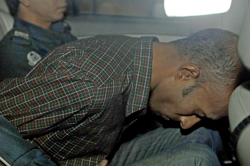 James Raj Arokiasamy, accused of hacking into the Ang Mo Kio Town Council's website, is being driven away after a court appearance on Nov 15, 2013. The alleged hacker pleaded guilty to 39 charges of computer misuse on Friday. -- ST PHOTO: WONG KWAI
