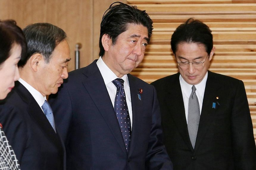 Japanese Prime Minister Shinzo Abe (second right) enters a room to attend a cabinet meeting at his official residence in Tokyo on Jan 23, 2015.Japan's government considered whether it had the legal basis for a military strike on Islamic State i