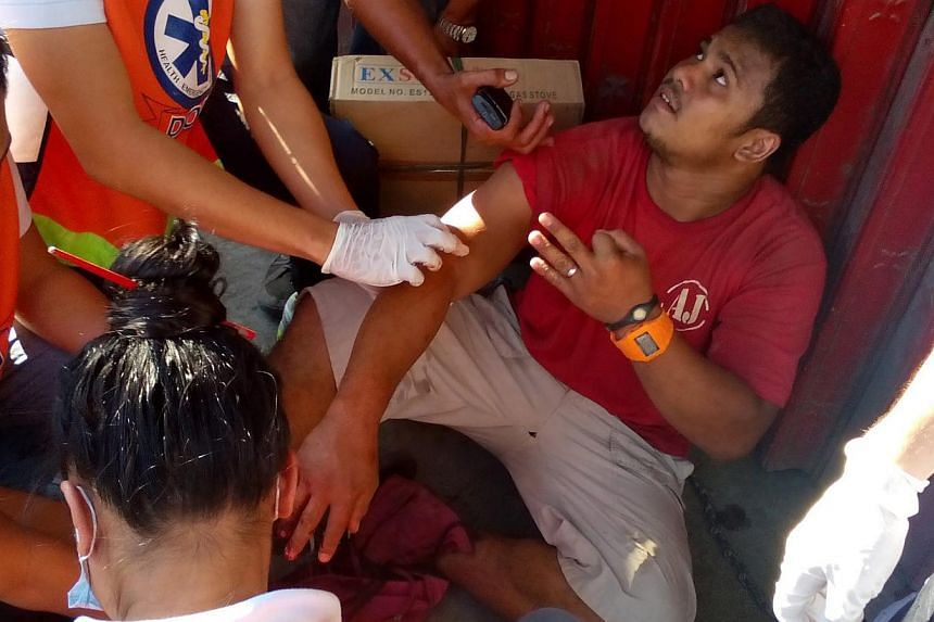 A wounded Filipino is attended by medical personnel after a blast occured at a bus terminal in Zamboanga city, Southern Philippines on Jan 23, 2015. -- PHOTO: EPA