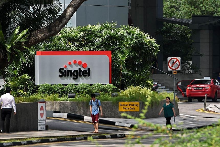 Singapore Telecom's (SingTel) new logo displayed on its building in Singapore. -- PHOTO: AFP