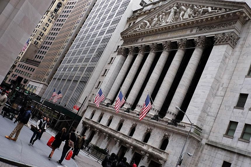 It was the fourth straight day of gains for Wall Street, a streak that erased losses that had mounted from the beginning of the new year. -- PHOTO: AFP