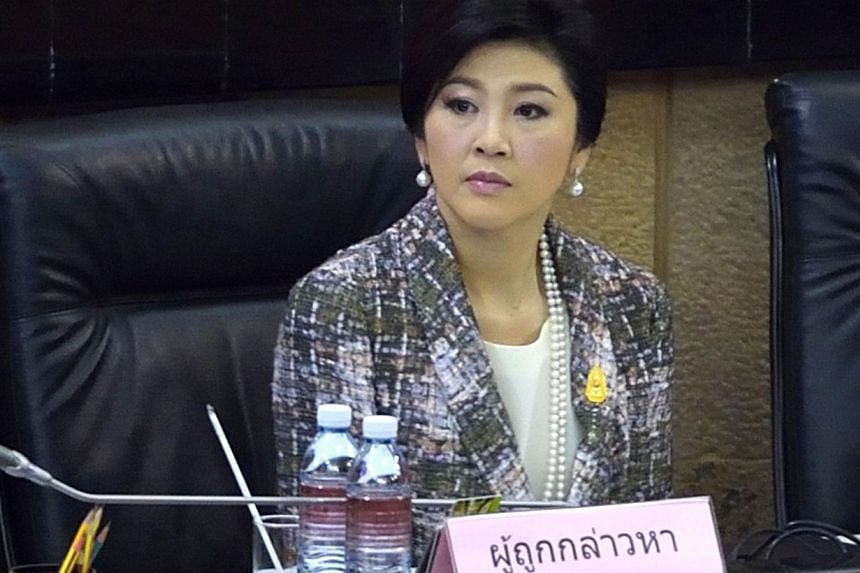 Ousted Thai prime minister Yingluck Shinawatra looks on during impeachment proceedings by the military-stacked National Legislative Assembly (NLA) at the parliament in Bangkok on Jan 22, 2015. -- PHOTO: AFP