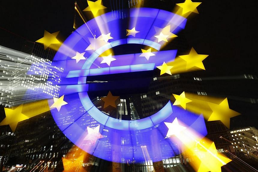 The famous euro sign landmark is photographed outside the former head quarters of the European Central Bank in Frankfurt, late evening Jan 20, 2015. -- PHOTO: REUTERS