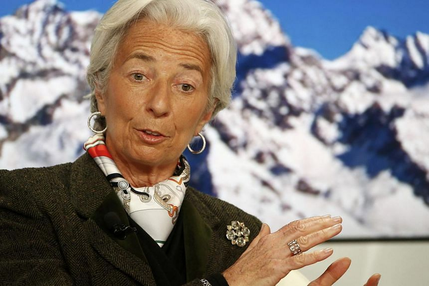 IMF managing director Christine Lagarde speaks at the Ending the Experiment event in the Swiss mountain resort of Davos Jan 22, 2015.It was supposed to be a serious debate about the merits of monetary stimulus, but instead a panel in Davos on T