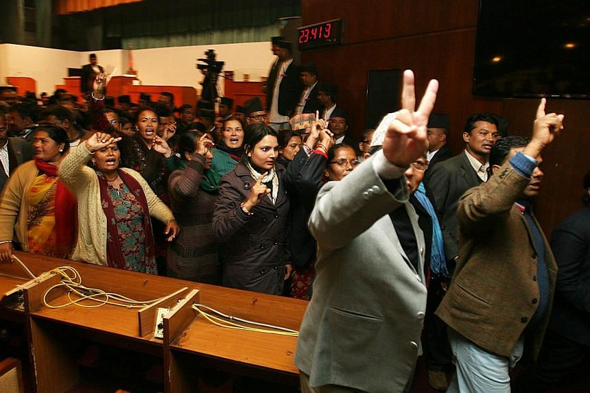 Constitution assembly members shout slogans before leaving the Constitution Assembly hall in Kathmandu, Nepal, Jan 22 2015. Nepal's lawmakers failed to agree on a new constitution Thursday as a midnight deadline expired, deepening public frustration