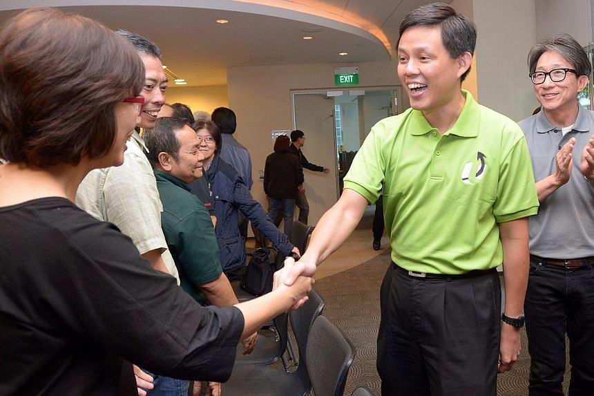 Minister Chan Chun Sing (second, right), accompanied by Minister Lim Swee Say, arriving and greeting NTUC Union leaders at NTUC Centre on Jan 23, 2015. -- ST PHOTO: LIM SIN THAI