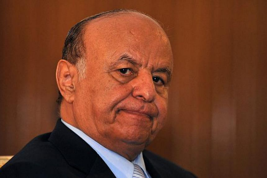 A 2013 file photo shows Yemeni president Abdrabuh Mansur Hadi at the presidential palace in Sana'a, Yemen. Hadi resigned on Thursday, a government spokesman said, throwing the country deeper into chaos days after Huthi rebels battled their